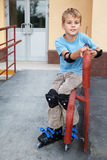 Boy in rollerblades, knee and elbow pads Royalty Free Stock Image