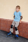 Boy in rollerblades, knee and elbow pads Royalty Free Stock Photography