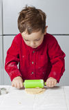 Boy Rolling Dough Royalty Free Stock Photos