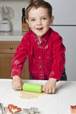 Boy Rolling Dough Stock Photos