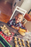 Boy rolling out dough for christmas cookies. Child rolling out dough for christmas cookies Stock Image