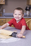 Boy rolling pin Stock Images