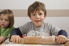 Boy with a rolling pin Royalty Free Stock Image