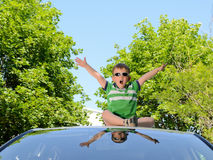 Boy on the roof of car Royalty Free Stock Photography