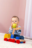 The boy in the room eating. Royalty Free Stock Image