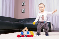 The boy in the room, playing with abandon. Stock Photos
