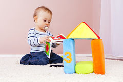 Boy in the room, playing happily. Royalty Free Stock Photos