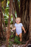 The boy in the roots of ficus Stock Photos