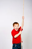 Boy with a rope Stock Photography