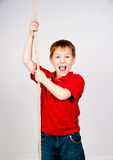 Boy with a rope Stock Images