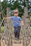 Boy on a rope bridge Stock Photography