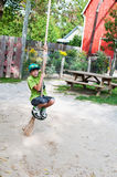 Boy on a rope swing Stock Photography