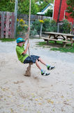 Boy on a rope swing Stock Image