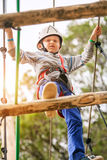 Boy on the rope track in adrenalin park Royalty Free Stock Image