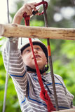 Boy on the rope track close up image Stock Images
