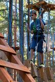 Boy on the ropes course Attractions (03) Stock Photo