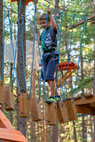 Boy on the ropes course Attractions (02) Royalty Free Stock Photos