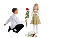 Boy with rose and girl Stock Images