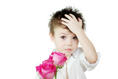 Boy and roses. Young boy with pink roses on white background Royalty Free Stock Images