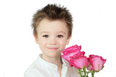 Boy and roses. Young boy with pink roses on white background Stock Image