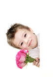 Boy and roses. Small boy peeping out through the wall Royalty Free Stock Image