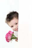 Boy and roses Royalty Free Stock Image