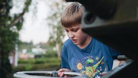 The boy rotates the metal steering wheel control anti-aircraft installation. Child development. Entertainments. Good mood stock video