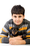 Boy with rottweiler puppy. Young boy with a tiny rottweiler puppy Royalty Free Stock Photos