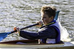 A boy in a row club in Poland. Hard work on a sport form in rowing and canoeing Royalty Free Stock Photo