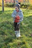 Boy with rowan berries Royalty Free Stock Photo