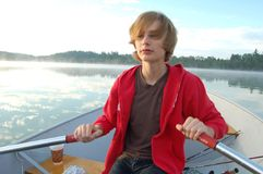 Boy Rowing A Boat Royalty Free Stock Images