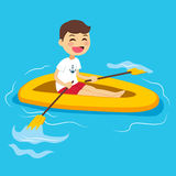 Boy Rowing Boat Royalty Free Stock Photos