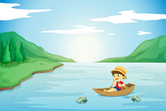 A boy rowing in a boat Royalty Free Stock Photos