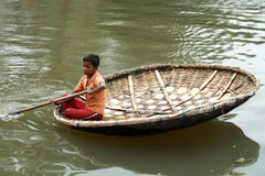 Boy rows a traditional boat Royalty Free Stock Photos