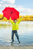 Boy in rubber boots Royalty Free Stock Image