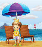 A boy with a rubber duck at the beach Royalty Free Stock Image