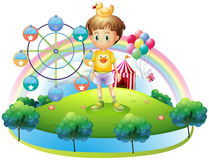 A boy with a rubber duck in an island with a carnival. Illustration of a boy with a rubber duck in an island with a carnival on a white background Stock Photography
