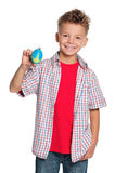 Boy with rugby ball. Happy boy holding small rugby ball in hand isolated on white background royalty free stock photography