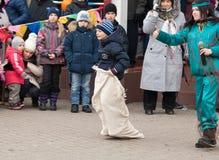 Boy run in bag Royalty Free Stock Photography