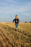 Boy is runing stock photo
