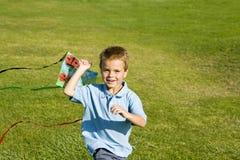 Boy running. Little boy running with a kite Stock Photos