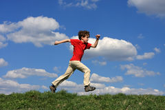 Boy running. On green meadow Royalty Free Stock Photography