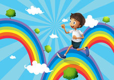 A boy running above the rainbow Royalty Free Stock Photography