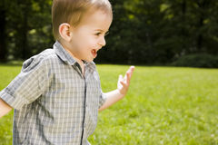 Boy running across field Royalty Free Stock Photography