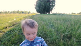 Boy running across hill in slowmotion stock video footage