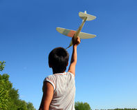 Boy running airplane model Stock Image
