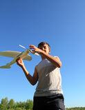 Boy running airplane model Stock Images