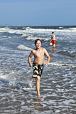 Boy running along the beach Royalty Free Stock Photo