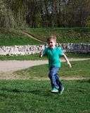 Boy running along the forest path. Active start Stock Photos