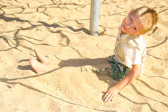 Boy running along the sand Stock Photography